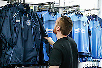 A fan looks at the new merchandise in the club shop during the 2016/17 Kit Launch of Wycombe Wanderers to the public at Adams Park, High Wycombe, England on 10 July 2016. Photo by David Horn.