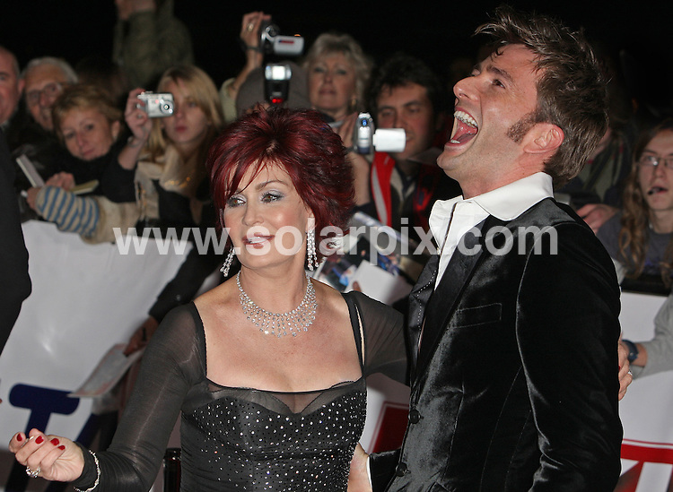 **ALL ROUND PICTURES FROM SOLARPIX.COM**.**WORLDWIDE SYNDICATION RIGHTS**.Guests attend the 2007 National Television Awards at the Royal Albert Hall, Kensington, London. 31st October 2007..This pic: Sharon Osbourne and David Tennant..JOB REF: 5242 SSD     DATE: 31_10_2007.**MUST CREDIT SOLARPIX.COM OR DOUBLE FEE WILL BE CHARGED* *UNDER NO CIRCUMSTANCES IS THIS IMAGE TO BE REPRODUCED FOR ANY ONLINE EDITION WITHOUT PRIOR PERMISSION*