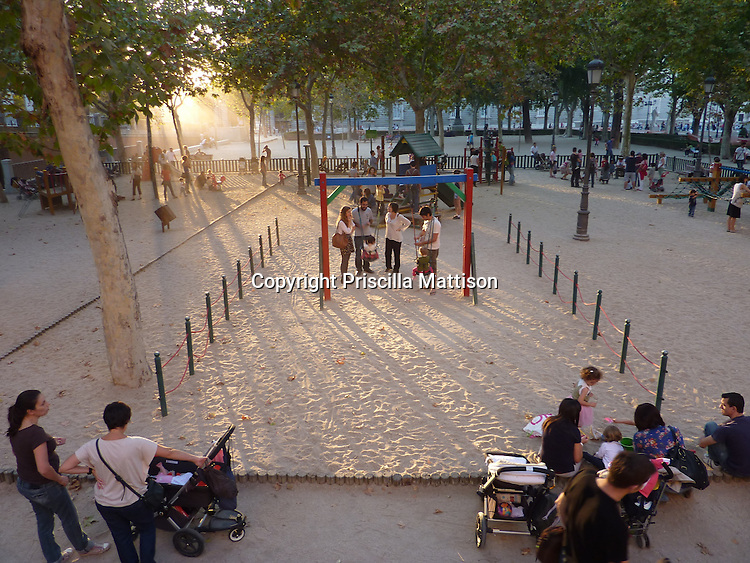 Madrid, Spain - October 15, 2011:  Parents chat in a playground in late afternoon.