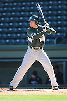 Second baseman kevin Goergen (14) of the Michigan State Spartans hits in a game against the Northwestern Wildcats on Sunday, February 17, 2013, at Fluor Field at the West End in Greenville, South Carolina. Michigan State won, 7-4. (Tom Priddy/Four Seam Images)