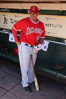 OAKLAND, CA - JUNE 10:  Juan Rivera #20 of the Los Angeles Angels of Anaheim gets ready in the dugout before the game against the Oakland Athletics at the Oakland-Alameda County Coliseum on June 10, 2010 in Oakland, California. Photo by Brad Mangin