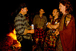 'CLAN, THE' SCOTLAND, A GROUP WHO SPEND THEIR WEEKENDS AT A CAMP IN GLEN CROE, RECREATING THE LIFE OF A SCOTTISH CLAN BEFORE THE DEFEAT OF BONNIE PRINCE CHARLIE BY THE ENGLISH AT THE BATTLE OF CULLODEN IN 1746. CHATTING WITH OTHER PARTY GOERS AT A BIRTHDAY CEILIDH HELD IN ADFERN ON THE WEST COAST, 1989
