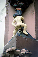 Goslar: Ducat Man beneath Statue of Abundance--demonstrating Goslar's right to mint coins. On gabled ridge of Kaiserworth Building. Photo '87.
