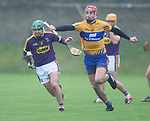 Shaun Murphy of Wexford in action against Peter Duggan of Clare during the Jack Lynch Memorial game at Tulla. Photograph by John Kelly.