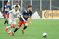 FOXBOROUGH, MA - APRIL 17: Ryan Sierakowski #99 of New England Revolution II  brings the ball forward during a game between Richmond Kickers and Revolution II at Gillette Stadium on April 17, 2021 in Foxborough, Massachusetts.