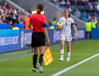 LE HAVRE,  - JUNE 20: Kelley O'Hara #5 talks to the assistant referee during a game between Sweden and USWNT at Stade Oceane on June 20, 2019 in Le Havre, France.