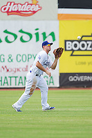 Chattanooga Lookouts left fielder Scott Schebler (8) catches a fly ball during the game against the Montgomery Biscuits at AT&T Field on July 23, 2014 in Chattanooga, Tennessee.  The Lookouts defeated the Biscuits 6-5. (Brian Westerholt/Four Seam Images)