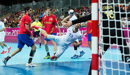 08 AUG 2012 - LONDON, GBR - Nikola Karabatic (FRA) of France (centre) shoots during the men's London 2012 Olympic Games quarter final match against Spain at the Basketball Arena in the Olympic Park, in Stratford, London, Great Britain (PHOTO (C) 2012 NIGEL FARROW)