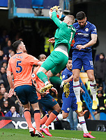 Everton's Jordan Pickford makes a save despite the attentions of Chelsea's Olivier Giroud<br /> <br /> Photographer Stephanie Meek/CameraSport<br /> <br /> The Premier League - Chelsea v Everton - Sunday 8th March 2020 - Stamford Bridge - London<br /> <br /> World Copyright © 2020 CameraSport. All rights reserved. 43 Linden Ave. Countesthorpe. Leicester. England. LE8 5PG - Tel: +44 (0) 116 277 4147 - admin@camerasport.com - www.camerasport.com