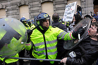 UK. London. 1st April 2009.. a policeman pushes back demonstrators outside the bank of england.©Andrew Testa for the New York times