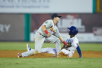Diego Hernandez (4) of the Burlington Royals is tagged out by Johnson City Cardinals shortstop Mateo Gil (23) as he attempts to steal second base at Burlington Athletic Stadium on September 4, 2019 in Burlington, North Carolina. The Cardinals defeated the Royals 8-6 to win the 2019 Appalachian League Championship. (Brian Westerholt/Four Seam Images)