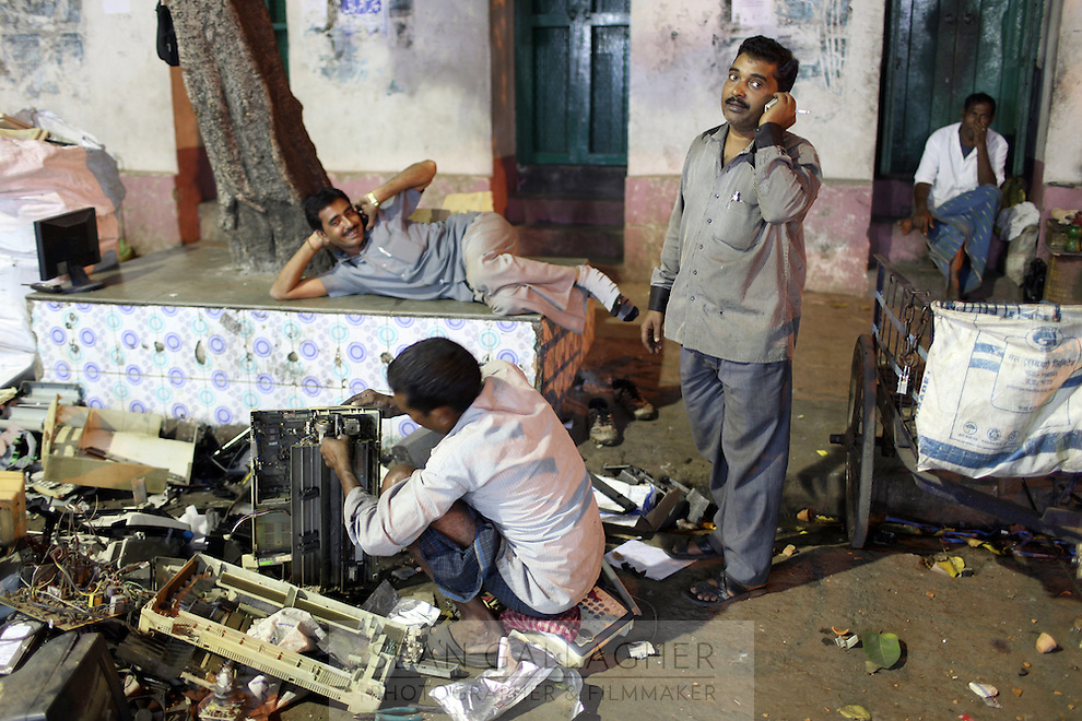 Secondhand electronics dealers begin the breakdown process in the Chandi Chowk electronics market district in Kolkata, India. November, 2013