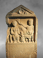 Second century Roman Christian funerary stele for 3 dead people from Africa Proconsularis. The stele depicts the deceased:  Fausata who died age 75, a man who died age 70 and a child who died age 2 years 6 months. From the first half of the second century AD from the region of Bou Arada in present day Tunisia. The Bardo National Museum, Tunis, Tunisia. Against a grey art background.