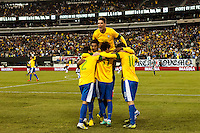 Neymar (11) of Brazil celebrates scoring with teammates. Brazil (BRA) and Colombia (COL) played to a 1-1 tie during international friendly at MetLife Stadium in East Rutherford, NJ, on November 14, 2012.