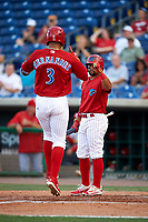 Clearwater Threshers third baseman Jan Hernandez (3) is congratulated by Drew Stankiewicz (15) as he crosses home plate after hitting a home run in the bottom of the second inning during a game against the Palm Beach Cardinals on April 14, 2017 at Spectrum Field in Clearwater, Florida.  Clearwater defeated Palm Beach 6-2.  (Mike Janes/Four Seam Images)