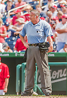 30 August 2015: MLB Umpire Dale Scott works home plate during a game between the Miami Marlins and the Washington Nationals at Nationals Park in Washington, DC. The Nationals rallied to defeat the Marlins 7-4 in the third game of their 3-game weekend series. Mandatory Credit: Ed Wolfstein Photo *** RAW (NEF) Image File Available ***