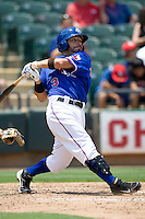 Shortstop Omar Quintanilla #3 of the Round Rock Express hits against the Nashville Sounds in Pacific Coast League baseball on May 9, 2011 at the Dell Diamond in Round Rock, Texas. (Photo by Andrew Woolley / Four Seam Images)