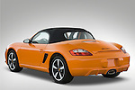 Rear three quarter view of a 2008 Porsche Boxster LE, with the top up