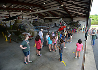 Gus Kuklinsk (center) speaks Thursday, June 10, 2021, to a large group of students from Alma while leading a tour at the Arkansas Air and Military Museum in Fayetteville. The students are participants in Camp Airedale, a three-week summer camp focused on experiences and relationship building for students in the school district that features a field trip each week. Visit nwaonline.com/210611Daily/ for today's photo gallery.<br /> (NWA Democrat-Gazette/Andy Shupe)