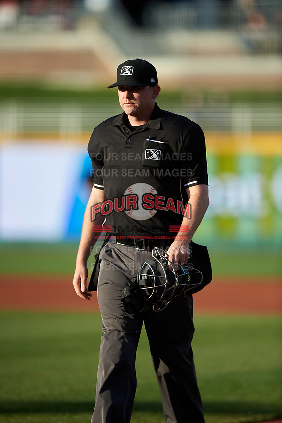 Home plate umpire Pete Talkington during a Midwest League game between the Beloit Snappers and Lansing Lugnuts at Cooley Law School Stadium on May 4, 2019 in Lansing, Michigan. Beloit defeated Lansing 2-1. (Zachary Lucy/Four Seam Images)