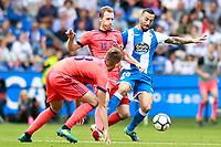 Deportivo de la Coruna's Guilherme Dos Santos (r) and Real Sociedad's Adnan Januzaj (l) and David Zurutuza during La Liga match. September 10,2017.  *** Local Caption *** © pixathlon<br /> Contact: +49-40-22 63 02 60 , info@pixathlon.de