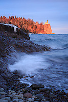 """""""Golden Hour at Split Rock Lighthouse""""<br /> As the sun sank toward the horizon, Split Rock Lighthouse was bathed in its magic light, while gentle waves lapped at Lake Superior's shores. Just a short drive up the shore from Duluth, Minnesota, Split Rock Lighthouse State Park is a favorite destination for many visitors and locals. Set atop a 130 foot (40 m) cliff on Lake Superior, the elevation of the light is 168 feet (51 m), and was visible from 25 miles (40 km) or more. The Fresnel lens is a 2.5-ton, double bull's-eye lens.The lighthouse was built following the fateful Mataafa Storm of 1905, in which 29 ships were lost. It guided ships from 1910 through 1969, at which time it was retired and added to the National Register of Historic Places."""