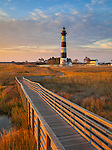 Cape Hatteras National Seashore, North Carolina: Sunrise lights the Bodie Island lighthouse (1872) and boardwalk on North Carolina's Outer Banks