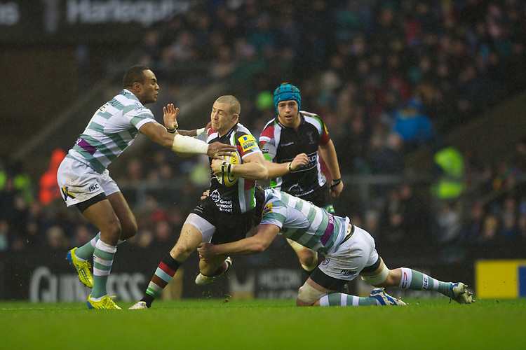 Mike Brown of Harlequins is tackled during the Aviva Premiership match between Harlequins and London Irish at Twickenham on Saturday 29th December 2012 (Photo by Rob Munro).