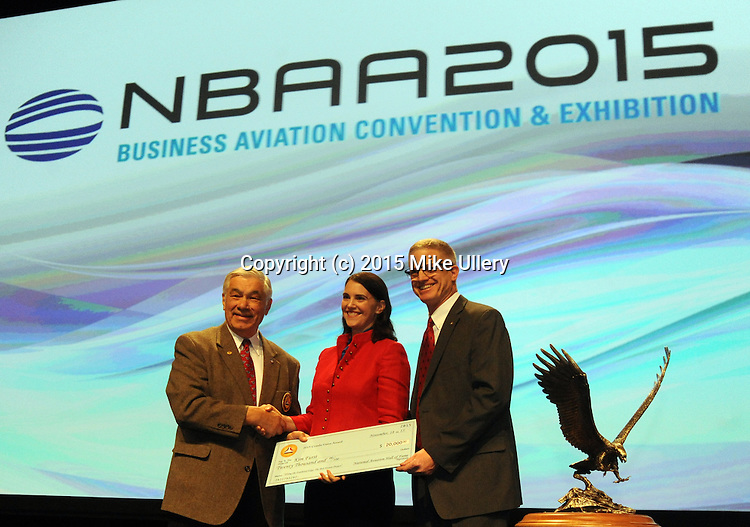 """NBAA Open Session on November 18, 2015 at the Las Vegas Convention Center. Among the highlights were the presentation of the National Aviation Hall of Fame Combs Gates Award to award-winning film maker Kim Furst. Furst received a check for $20,000 for her film, """"Flying the Feathered Edge: The Bob Hoover Project"""". This was followed by the announcement of the the NAHF Class of 2016, including Robert L. Crippen, George E. """"Bud"""" Day, Christopher C. Kraft, Jr., and Tom Poberezny. Following the presentation of awards, """"Miracle on the Hudson"""" pilot Sully Sullenberger provided the keynote address."""