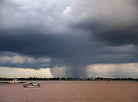 A heavy rainstorm over the Mekong River in Phnom Penh, Cambodia Monsoon Season in Phnom Penh
