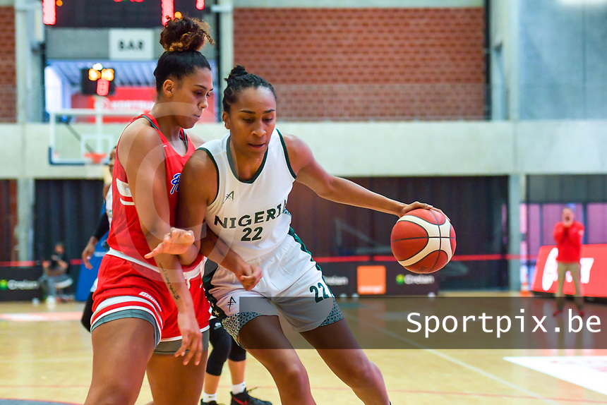 Oderah Chidom (22) of Nigeria India Pagan (33) of Puerto Rico pictured during a basketball game between Nigeria and Puerto Rico on Friday 28 th of May 2021 in Kortrijk , Belgium . PHOTO SPORTPIX.BE | SPP | STIJN AUDOOREN