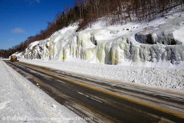Snow plow truck on Route 112 in Kinsman Notch of Woodstock, New Hampshire USA during the winter months.