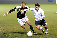 Andrew Bulls (17) of the UMBC Retrievers and Brandon Busch (11) of the Princeton Tigers batle for the all. UMBC Retrievers defeated Princeton Tigers 2-1 during the first round of the 2010 NCAA Division 1 Men's Soccer Championship at Roberts Stadium in Princeton, NJ, on November 18, 2010.