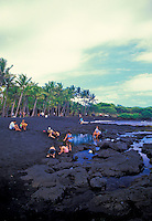 Punalu'u Black Sand Beach is a good place to see the unique black volcanic sand but also  resting green sea turtes.