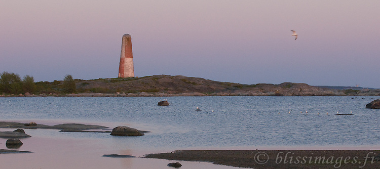 Dusk befalls Lyökki Daybeacon on rocky Pookinmaa Island, 5 km off Pyhämaa on the Southwest coast of Finland. Built of stone in 1757, it is Finland's oldest and best known beacon.