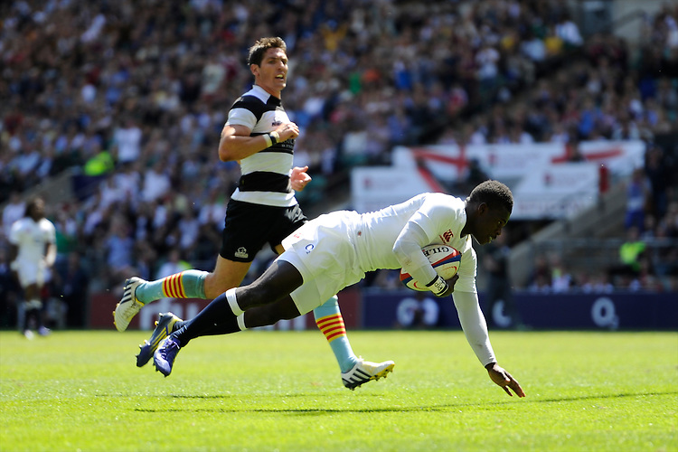 Christian Wade of England scores a try during the match between England and Barbarians at Twickenham on Sunday 26th May 2013 (Photo by Rob Munro)