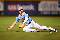 Omaha Storm Chasers shortstop Bobby Witt Jr. (7) makes a diving play during a game against the Iowa Cubs on August 14, 2021 at Werner Park in Omaha, Nebraska. (Zachary Lucy/Four Seam Images)