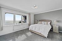 BNPS.co.uk (01202) 558833. <br /> Pic: ScottParry/BNPS<br /> <br /> Pictured: Bedroom. <br /> <br /> Life's a beach...<br /> <br /> A coastal clifftop home above a picturesque Cornish beach is on the market for £1.75m.<br /> <br /> High Seas sits in a prime position above Millendreath Beach in Looe, the 'Cornish Riviera', with spectacular views across Whitsand Bay and out to sea.<br /> <br /> The impressive five-bedroom property has almost 5,000 sq ft of living space and a decent sized garden, but it's real draw is its location.<br /> <br /> The house is 150 yards from Millendreath Beach and its garden gate will take the owners straight onto the South West Coast Path.