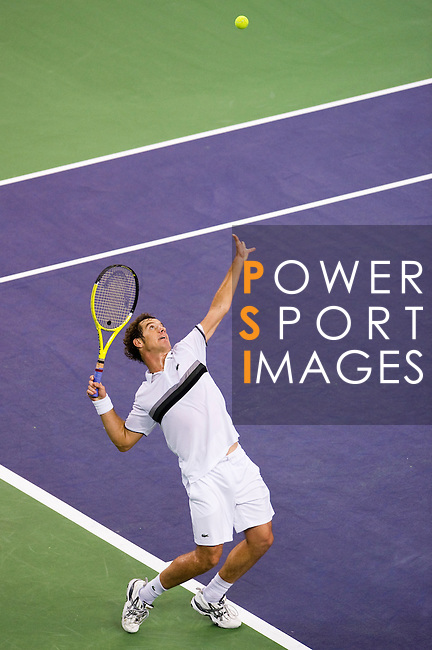 SHANGHAI, CHINA - OCTOBER 14:  Richard Gasquet of France serves to Novak Djokovic of Serbia during day four of the 2010 Shanghai Rolex Masters at the Shanghai Qi Zhong Tennis Center on October 14, 2010 in Shanghai, China.  (Photo by Victor Fraile/The Power of Sport Images) *** Local Caption *** Richard Gasquet