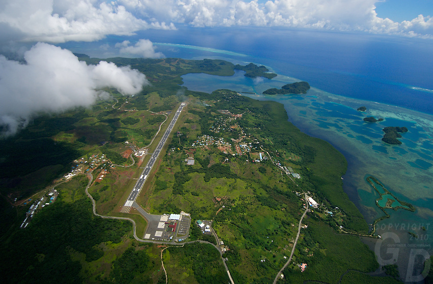 Aerial of the Palau, Micronesia International Airport from approx. 4000 feet, showing the airport lauyot and the ocean with  some of the Rock islands and reef October 2007