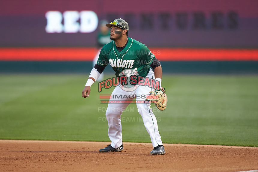 Charlotte 49ers first baseman Logan Sherer (25) on defense against the North Carolina State Wolfpack at BB&T Ballpark on March 29, 2016 in Charlotte, North Carolina. The Wolfpack defeated the 49ers 7-1.  (Brian Westerholt/Four Seam Images)