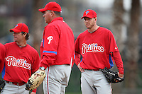 February 24, 2010:  Pitcher Roy Halladay (34 - right) and Jamie Moyer (left) of the Philadelphia Phillies listens during instruction while practicing at the Carpenter Complex in Clearwater, FL.  Photo By Mike Janes/Four Seam Images