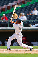Jordan Danks (23) of the Charlotte Knights follows through on his swing against the Gwinnett Braves at Knights Stadium on July 28, 2013 in Fort Mill, South Carolina.  The Knights defeated the Braves 6-1.  (Brian Westerholt/Four Seam Images)