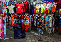 Children's Clothing for Sale at Nighttime Flea Market, Ipoh, Malaysia.