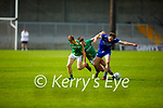 Jason Hickson of Annascaul tussles with Seamus O'Laighin and Seamus O'Grada of Castlegregory for possession  in the 2020 Junior football championship final