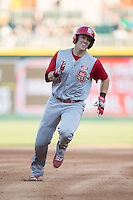 Logan Ratledge (6) of the North Carolina State Wolfpack hustles towards third base against the Charlotte 49ers at BB&T Ballpark on March 31, 2015 in Charlotte, North Carolina.  The Wolfpack defeated the 49ers 10-6.  (Brian Westerholt/Four Seam Images)