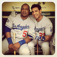 OAKLAND, CA - JUNE 21:  Instagram of Los Angeles Dodgers players Juan Uribe and Juan Rivera sitting in the dugout before the game against the Oakland Athletics at the O.co Coliseum on June 21, 2012 in Oakland, California. (Photo by Brad Mangin)