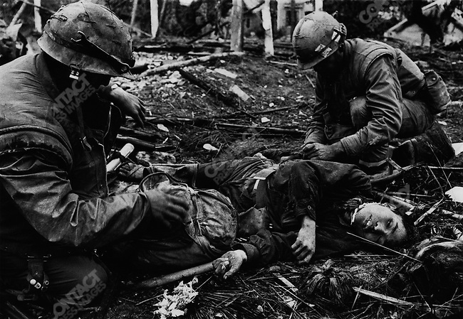 U.S. Marines with the body of a North Vietnamese soldier, Têt offensive, Battle of Hué, Vietnam, February 1968