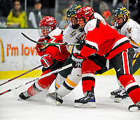 3 January 2009: St. Lawrence Saints' defenseman and Team Co-Captain Shawn Fensel (left), a Senior from Nepean, Ontario, in action against the University of Vermont Catamounts during the championship game of the Catamount Cup Ice Hockey Tournament at Gutterson Fieldhouse in Burlington, Vermont. The Cats defeated the Saints 4-0 and won the tournament for the second time since its inception in 2005...Mandatory Photo Credit: Ed Wolfstein Photo
