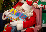TORRINGTON, CT. 20 December 2019-122019BS09 - Dakota Secor, 3 of Torrington, left, gives Santa a big thank-you hug while holding her christmas gift given to her by Santa, during  a visit by Santa at the FISH of Northwestern Connecticut Homeless Shelter in Torrington on Friday. Bill Shettle Republican-American